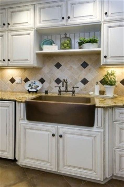 distressed white cabinets and copper sink kitchen of my