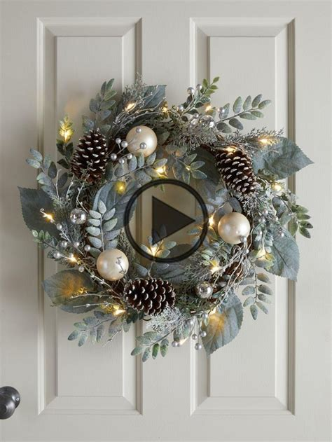 pre lit frosted wreath  cones  baubles  cm
