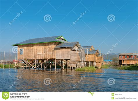 houses under water traditional stilts house in water under blue sky stock