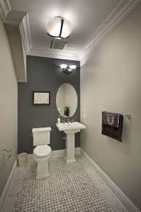 Traditional powder room with pedestal sink amp flush light