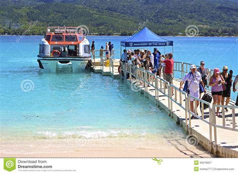 boat cruise pacific islands cruise tourists boarding a boat in vanuatu micronesia