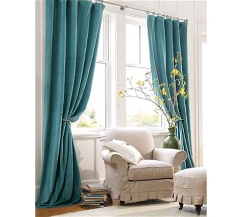 aqua velvet curtains decorating a rental apartment on a budget bossy color