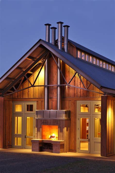 Elegant muskoka fireplace in Exterior Farmhouse with