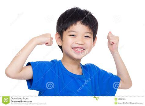 little boy flexing bicep asia little boy flexing biceps stock photo image 40942326