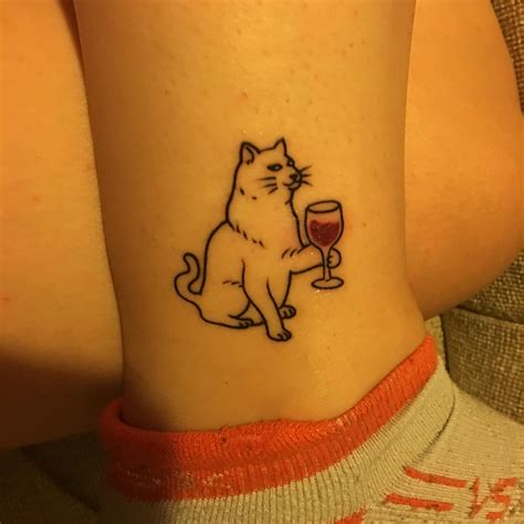 wine tattoo cat with wine by tim baxley at hold fast in webster tx