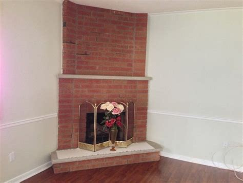 Corner Brick Fireplace by Need Help On Updating A Brick Layered Corner Fireplace