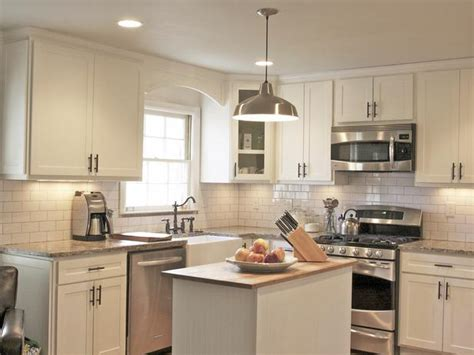 cottage style kitchen cabinets white cottage kitchen with stainless steel appliances hgtv