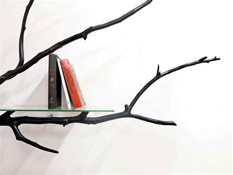 artist finds fallen tree branch on road turns it into