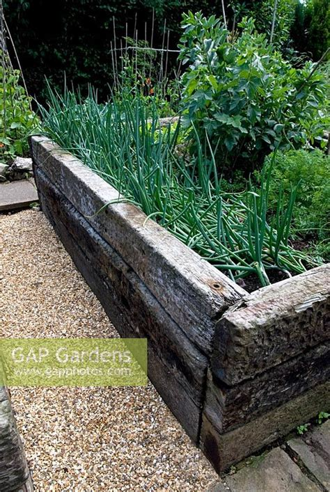 gap gardens railway sleepers used to make raised bed for