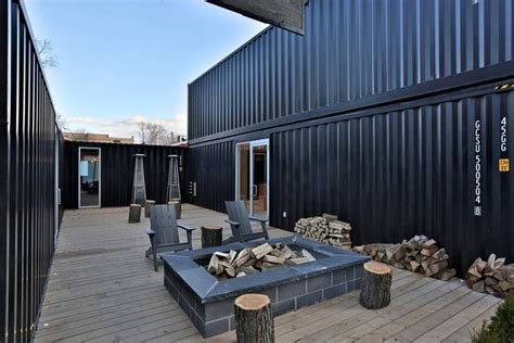 home and design show edmonton condo sales office is built out of shipping containers