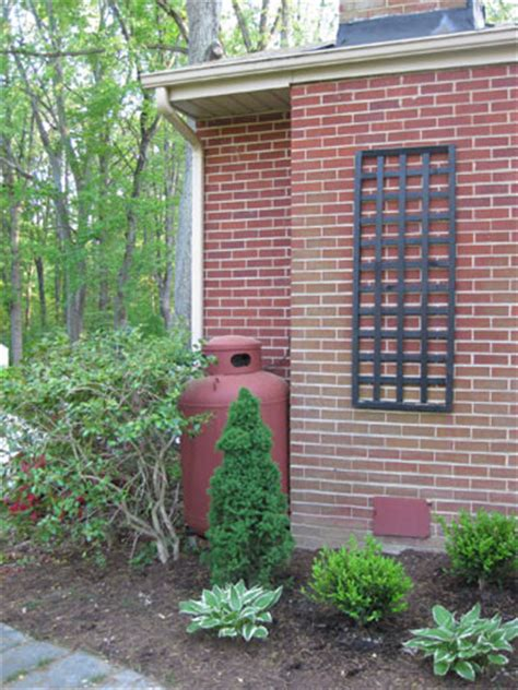 how to paint ugly utility boxes & propane tanks so they