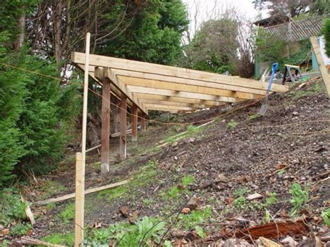 building a deck on a sloped backyard backyard with steep slope image gives a sight as to hop