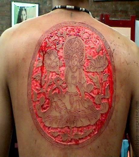 tattoo body modification think you re hardcore with your new tat try this i dare