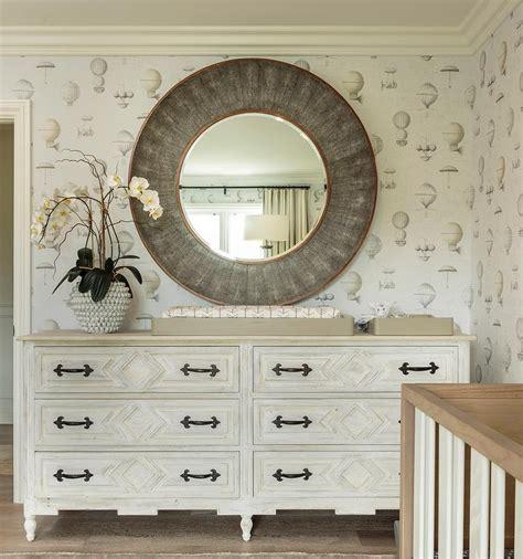 white mirror above dresser antiqued white french nursery dresser with round gray