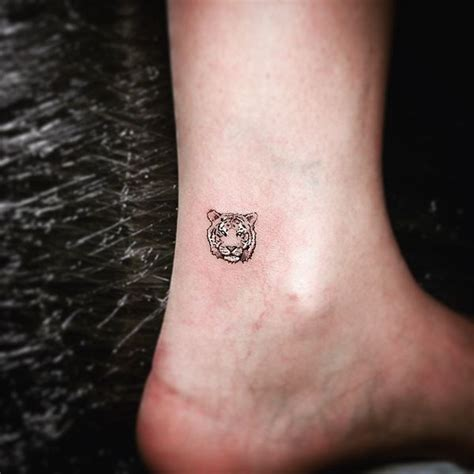 small butt tattoo tiger meaning and best designs flowertattooideas