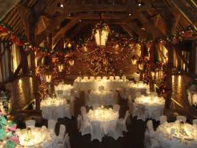 the tithe barn decorated for christmas wedding venue in