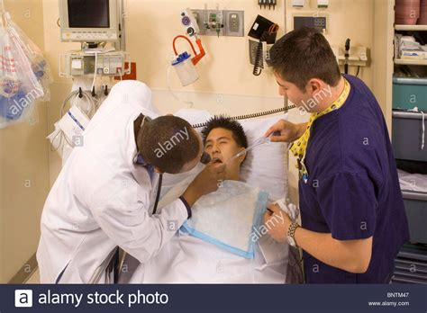 emergency room physician emergency room physician left examines overdose victim at stock photo royalty free