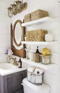 country bathroom with shelves installed above toilet decoist