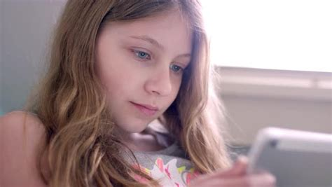 preteen models pimpandhost com preteen friends using their tablets together at home