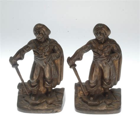 pair of vintage finish cast vintage pair of cast iron w bronze finish swashbuckler bookends poss nuart ebay