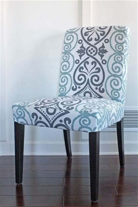 Picture of diy dining chair slipcover from a tablecloth