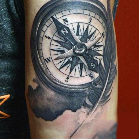 tattoo compass feather 70 feather tattoo designs for men masculine ink ideas