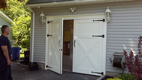 how to build swing out garage doors clingerman doors custom wood garage doors clearville pa