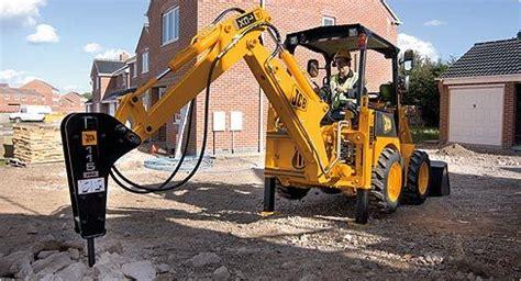backhoe jackhammer jcb s 1cx backhoe gets to work with the jackhammer