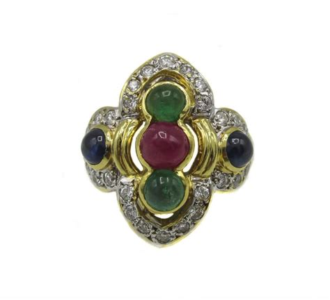 1980s gold ruby sapphire and emerald ring for