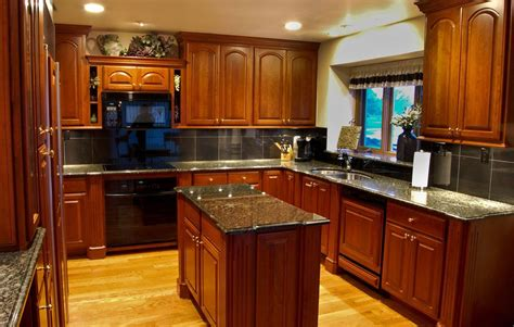 maple kitchen cabinets with black granite countertops mf