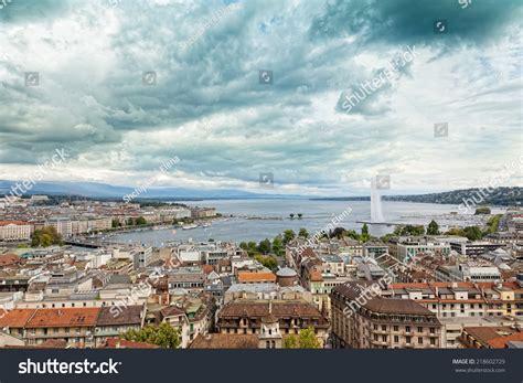Geneva Rise a jet d eau rises the waterfront of lake geneva geneva switzerland stock photo