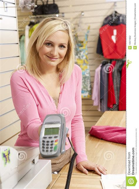 sales assistant in clothing store stock photo