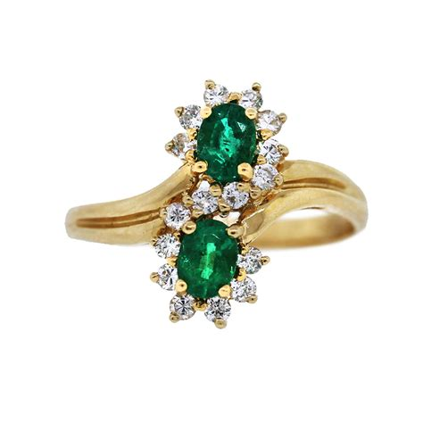 14k yellow gold and emerald bypass ring boca raton