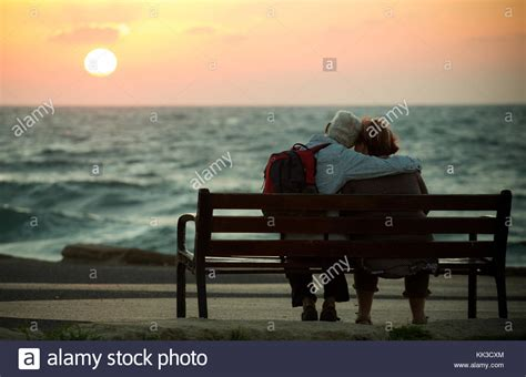 bench couple watch romantic couple in love watching stock photos romantic