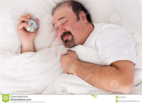 wake up everybody no more sleeping in bed man smiling in contentment after a good sleep stock photos image 36473973