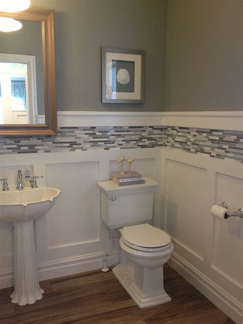 bathroom ideas with wainscoting white board and batten wainscot with glass tile inlay