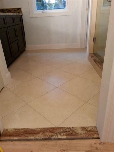 what kind of grout for bathroom floor bathroom main floor 18 quot x18 quot porcelain tile installed w 1