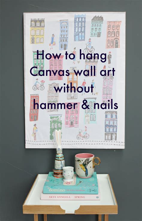 how to hang without nails littlebigbell hang a canvas on a wall without hammer and nails