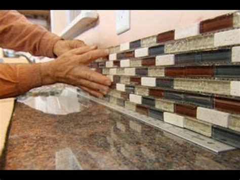 how to install a glass tile backsplash this house