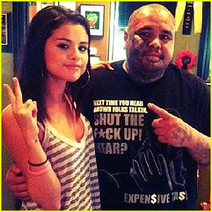 selena gomez cross tattoo miley cyrus gets new is vegan for