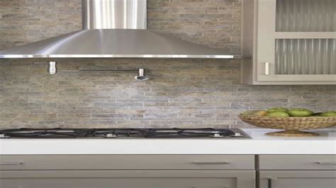 linear tiles backsplash taupe gray kitchen cabinets