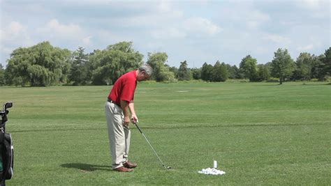practicing golf swing man practise hes golf swing on the range stock footage