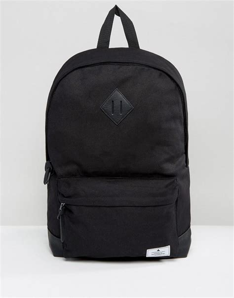 asos backpack in black canvas with faux leather base in