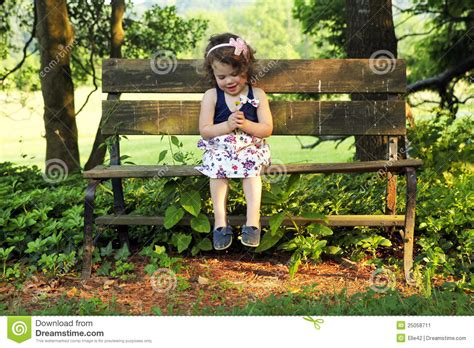 bench girl little girl on bench stock image image of bench stemmed