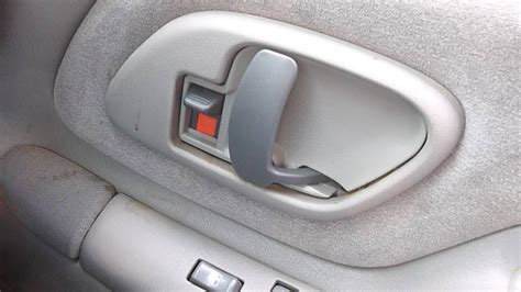How To Replace Car Door Handle Interior by Replacing The Inside Door Handle On A Suburban For