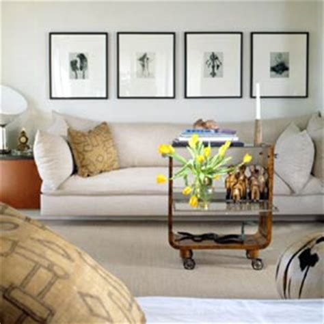 hanging pictures above couch how to hang art www decoresource com