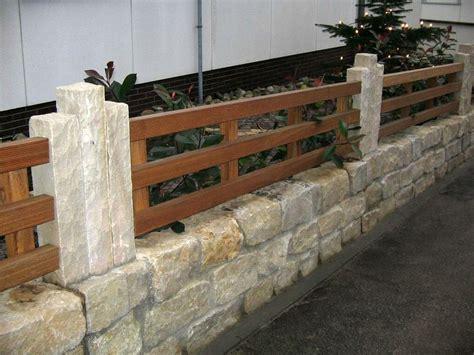 natursteinmauer mit lattenzaun haufler baumschule und