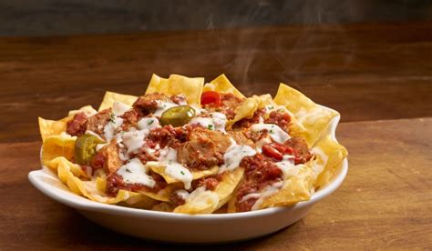 olive garden pizza bowl olive garden launches loaded pasta chips in time for bowl food newsfeed