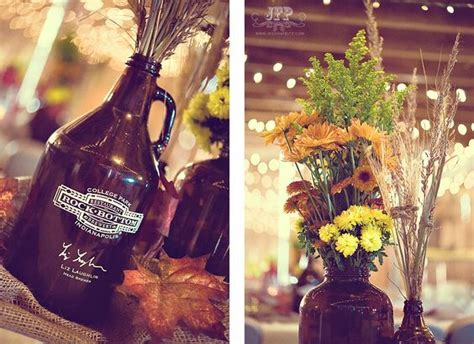 vicki and mike indiana rustic barn wedding jessika feltz beer growlers as vases for centerpiece flowers though the