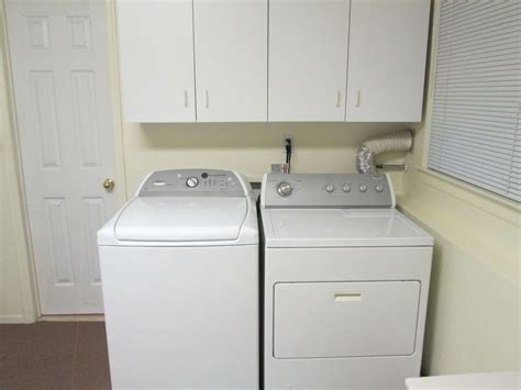 Contemporary Laundry Room With Undermount Built In